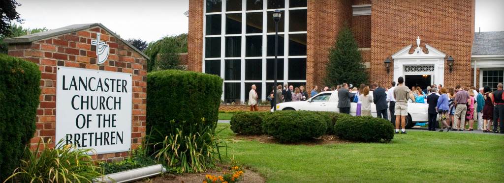 Photo of a wedding party exiting the church