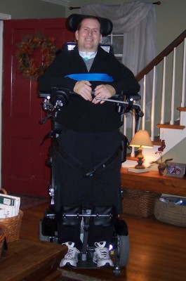 Jim is pictured with his standing wheelchair.