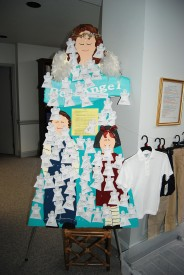 Photo of a large angel cut-out with names of children posted on it
